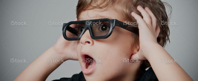stock-photo-16881593-kid-in-awe-gesture-while-watching-3-d-movie2